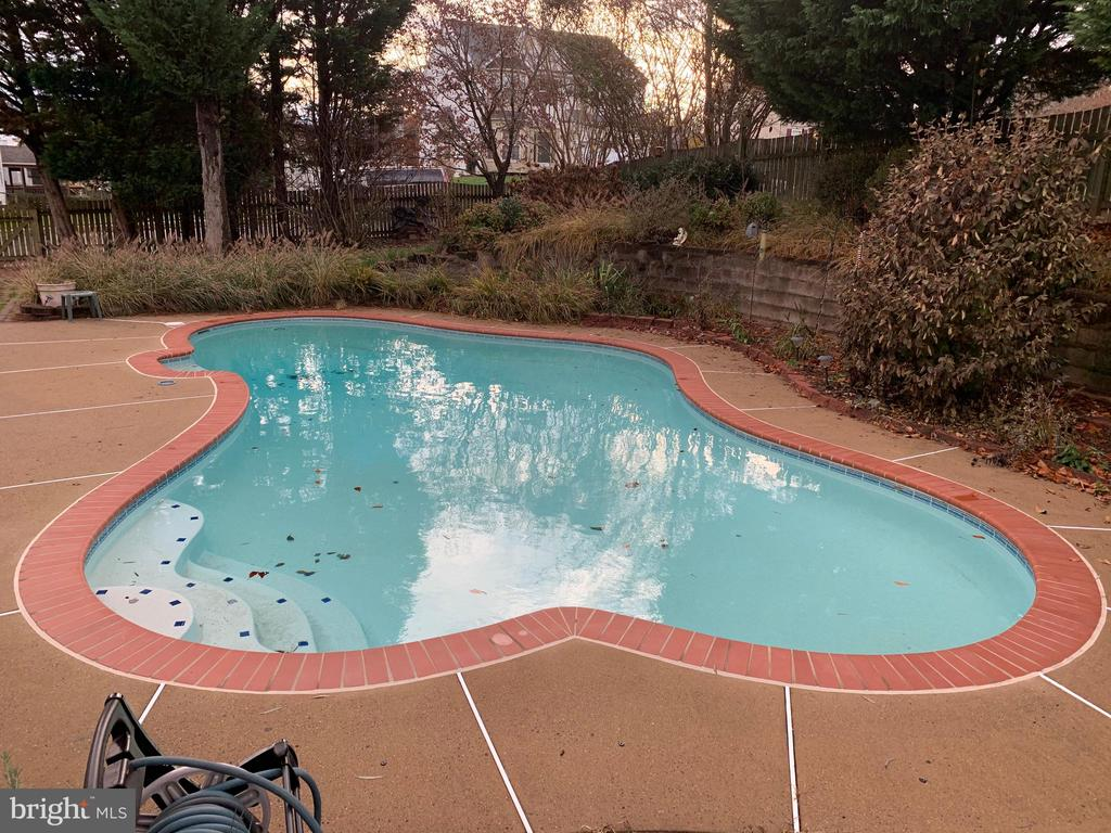 Nice cement decking surrounds the gunnite pool - 9337 S WHITT DR, MANASSAS PARK