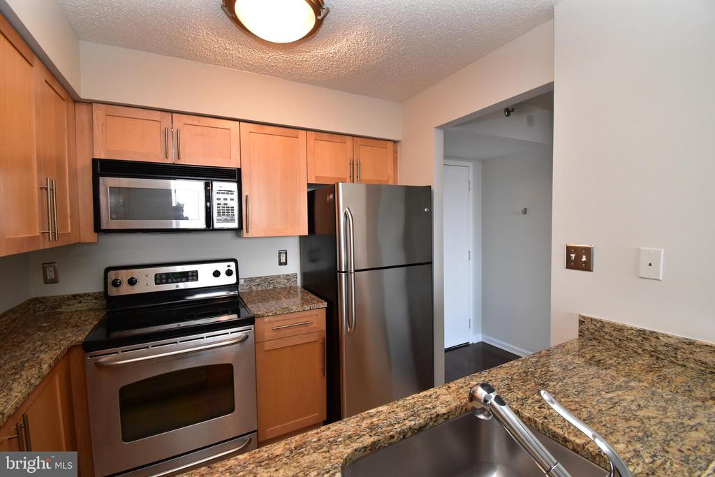 Kitchen with granite counters and ss appliances - 10101 GROSVENOR PL #1919, ROCKVILLE