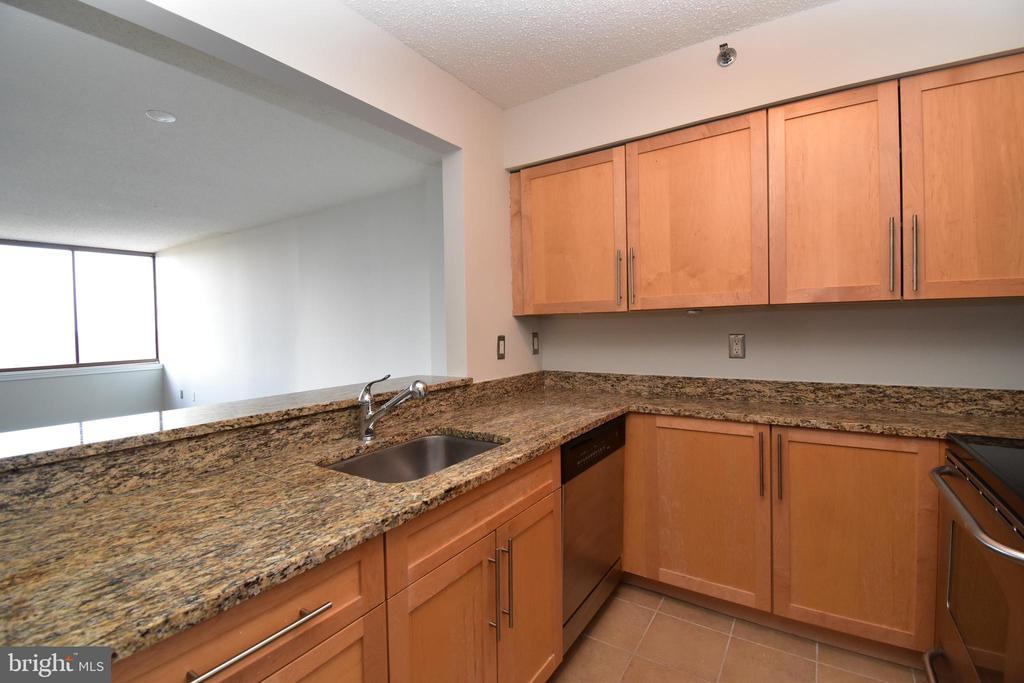 Kitchen open to living area - 10101 GROSVENOR PL #1919, ROCKVILLE
