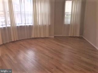 Master bedroom with new hardwood floors - 3835-102W 9TH ST N #102W, ARLINGTON