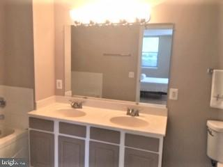 Updated bathroom-faucets, shower, and lights - 3835-102W 9TH ST N #102W, ARLINGTON