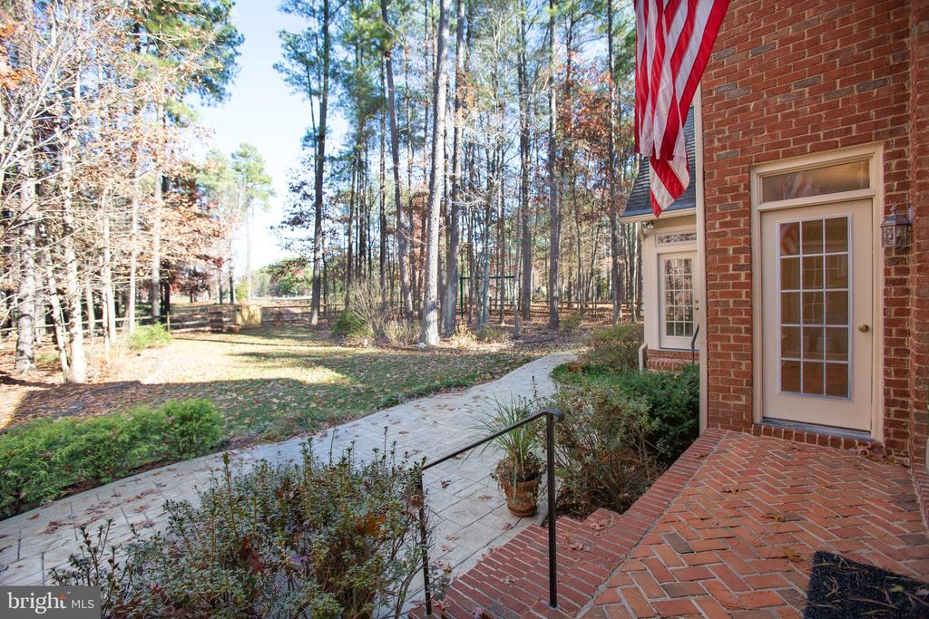Brick patio leads down to a stamped concrete patio - 11502 GENERAL WADSWORTH DR, SPOTSYLVANIA