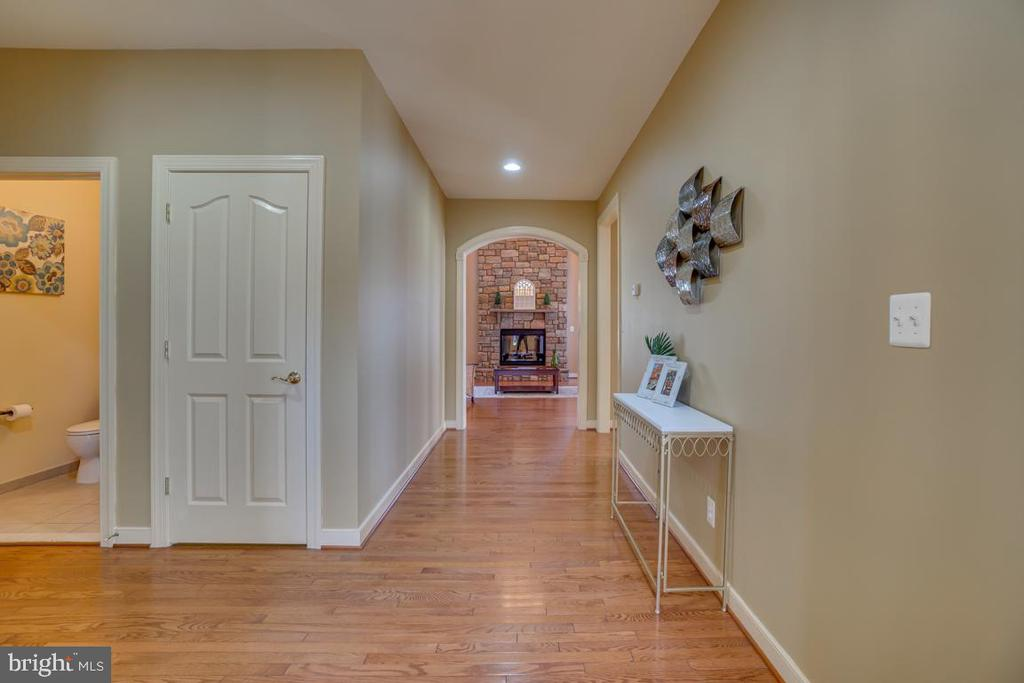 Center Hallway, Powder Room & Basement Door - 3 GRISTMILL DR, STAFFORD