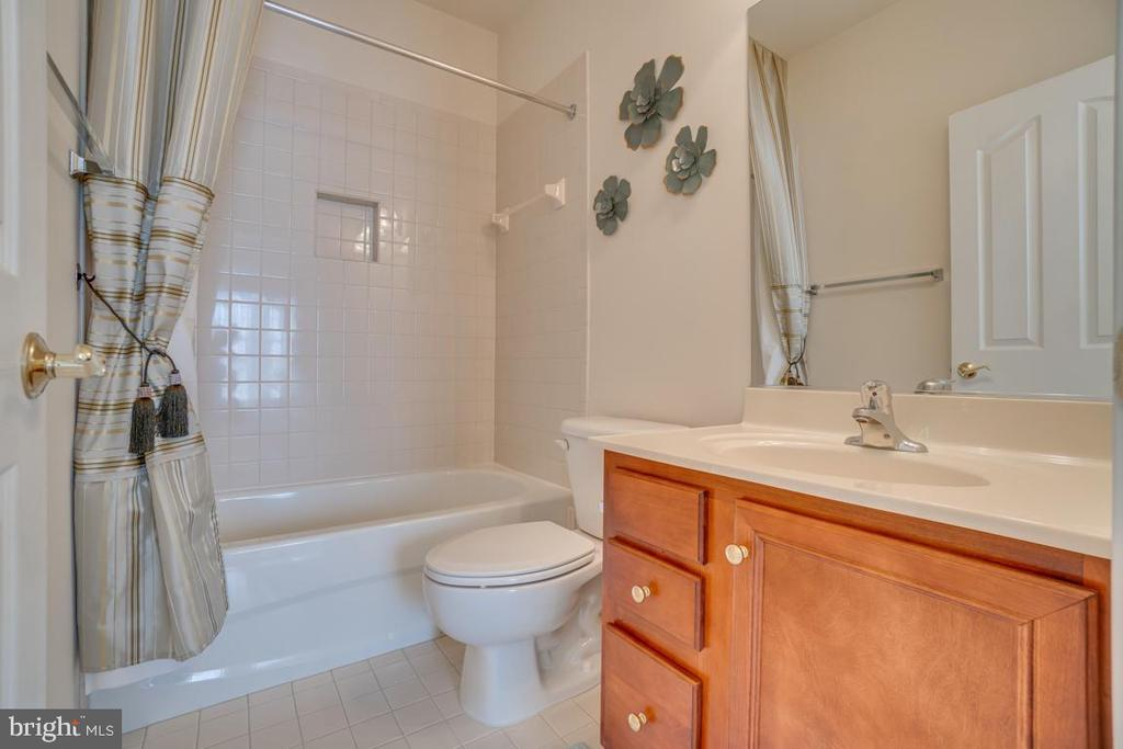 Bedroom Four with Full Bathroom and Vanity Storage - 3 GRISTMILL DR, STAFFORD