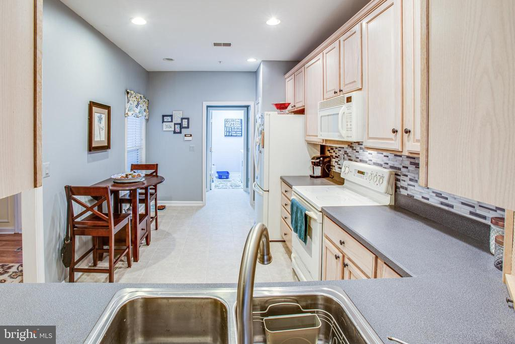 kitchen opening to mingle with guest - 93 LEGEND DR, FREDERICKSBURG
