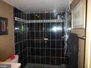 Black Tiled Shower w/Glass Doors - 1300 S ARMY NAVY DR #1005, ARLINGTON