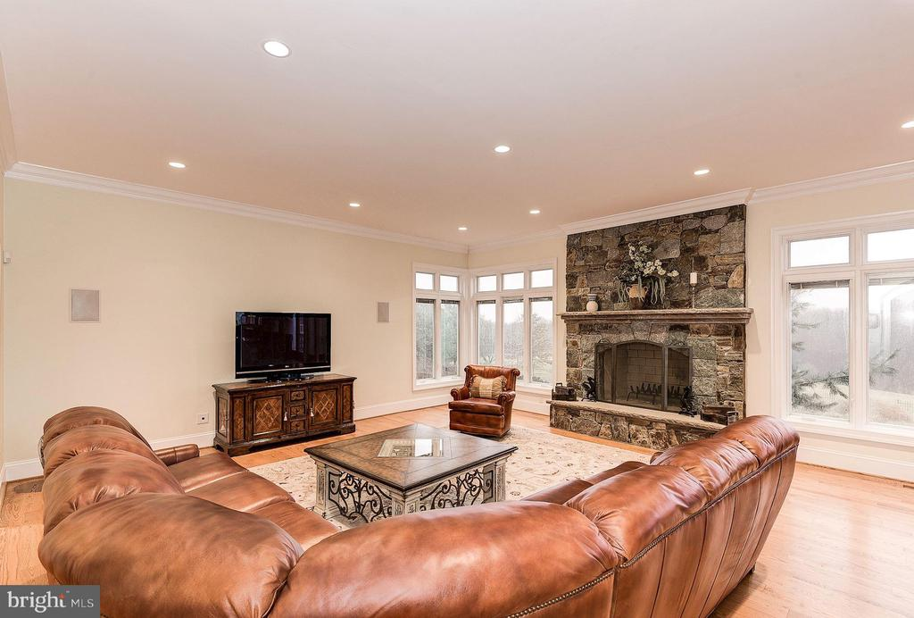 Family room with wood burning stone fireplace - 16311 BARNESVILLE RD, BOYDS