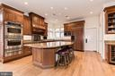 Kitchen island with seating - 16311 BARNESVILLE RD, BOYDS