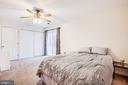 Master bedroom with sliding glass door - 35387 WILDERNESS SHORES WAY, LOCUST GROVE
