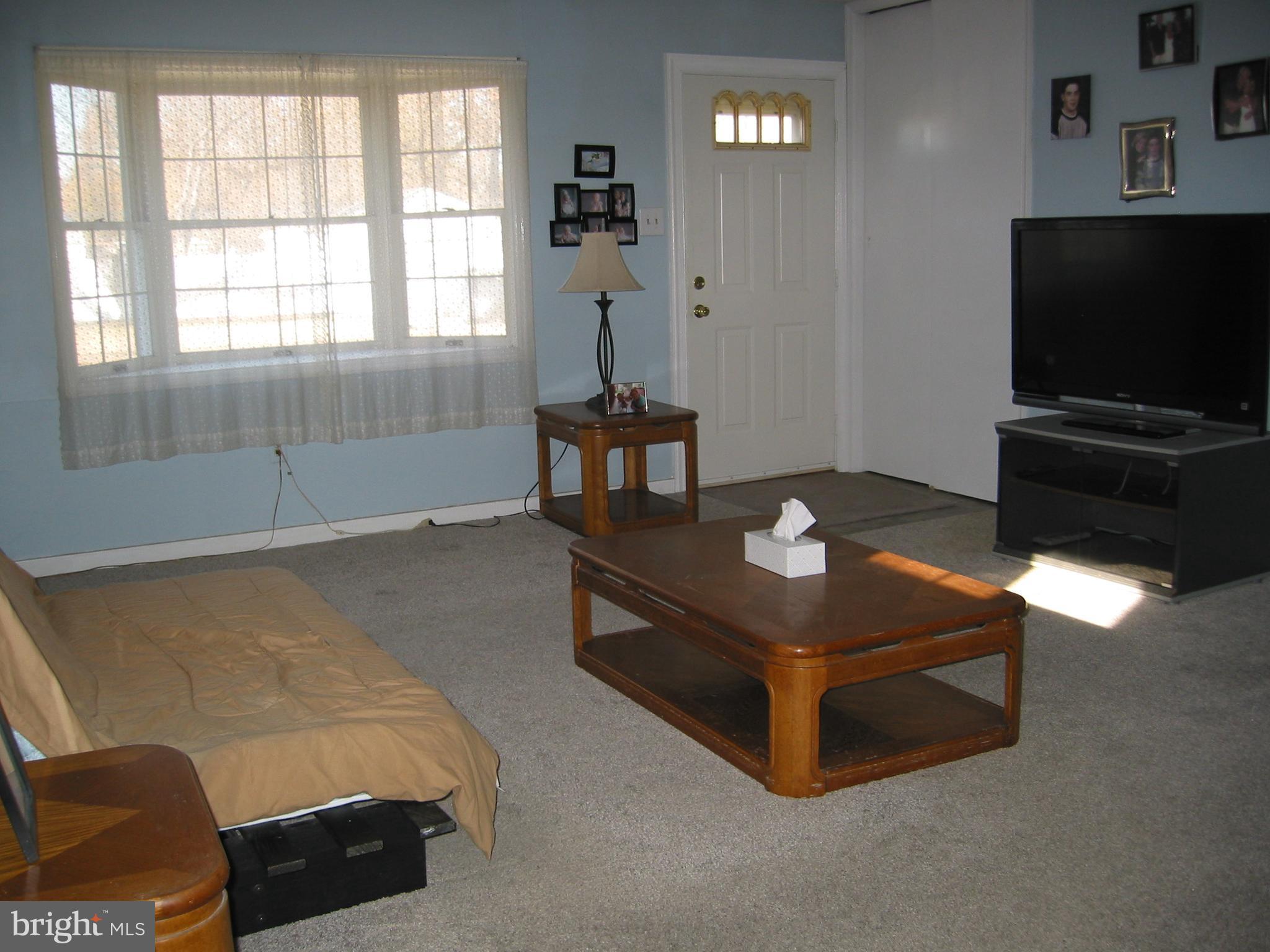 Living Room with Coat Closet & Bay Window