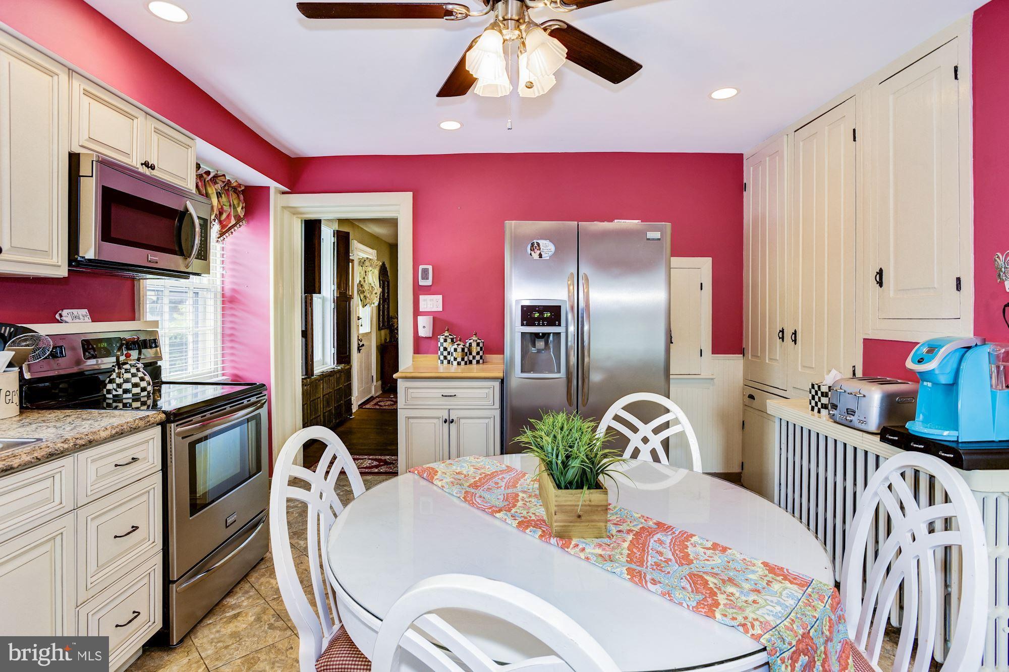 Original cabinetry has pass thru to Dining Rm