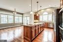 Pendant lights over island and recessed lights - 19999 BELMONT STATION DR, ASHBURN