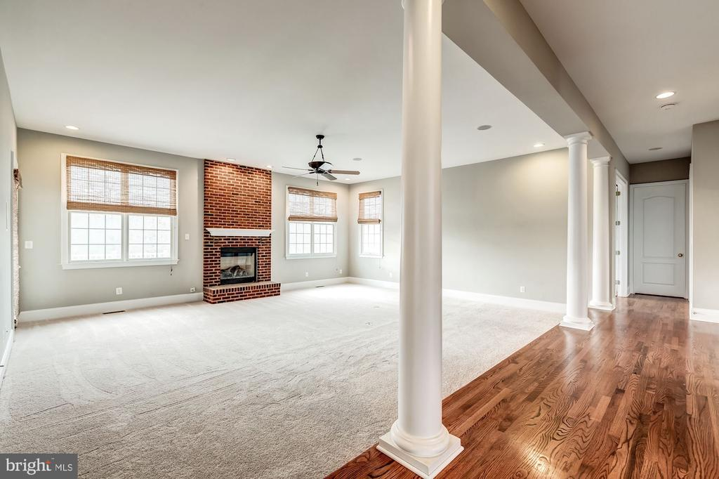 Family room with brand new carpet and brick gas FP - 19999 BELMONT STATION DR, ASHBURN