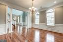 Formal dining room with gleaming hardwood floors - 19999 BELMONT STATION DR, ASHBURN
