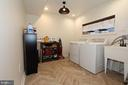 Newly finished laundry room with tile floors - 505 BRECKINRIDGE SQ SE, LEESBURG