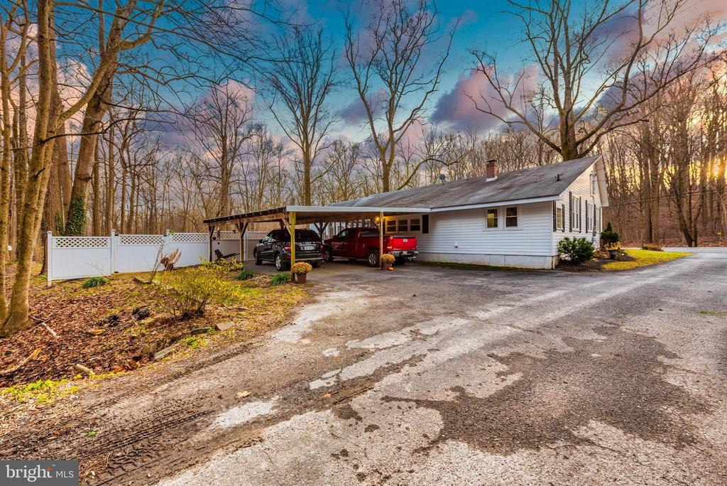 showing back of home - 15009 SABILLASVILLE RD, THURMONT
