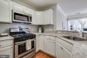 Open kitchen with almost new appliances! - 3842 CLORE PL, WOODBRIDGE