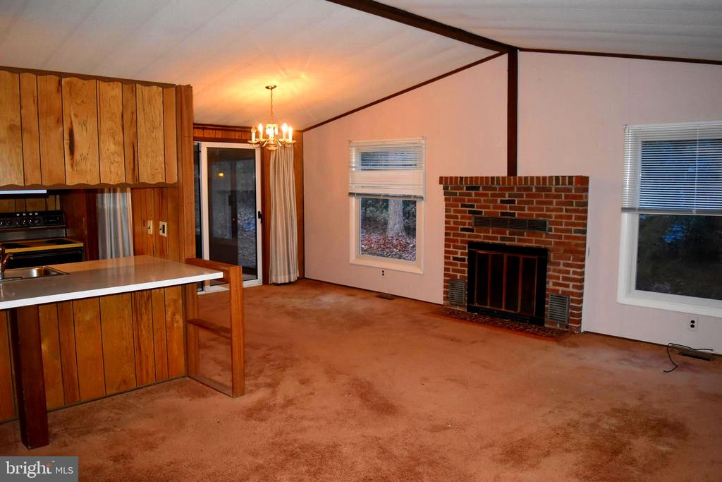 Living Room with wood fireplace towards dining - 208 MUSKET LN, LOCUST GROVE