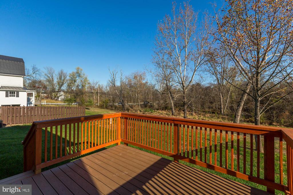 The deck is off the side of the home facing trees - 41217 & 41223 JOHN MOSBY HWY, ALDIE