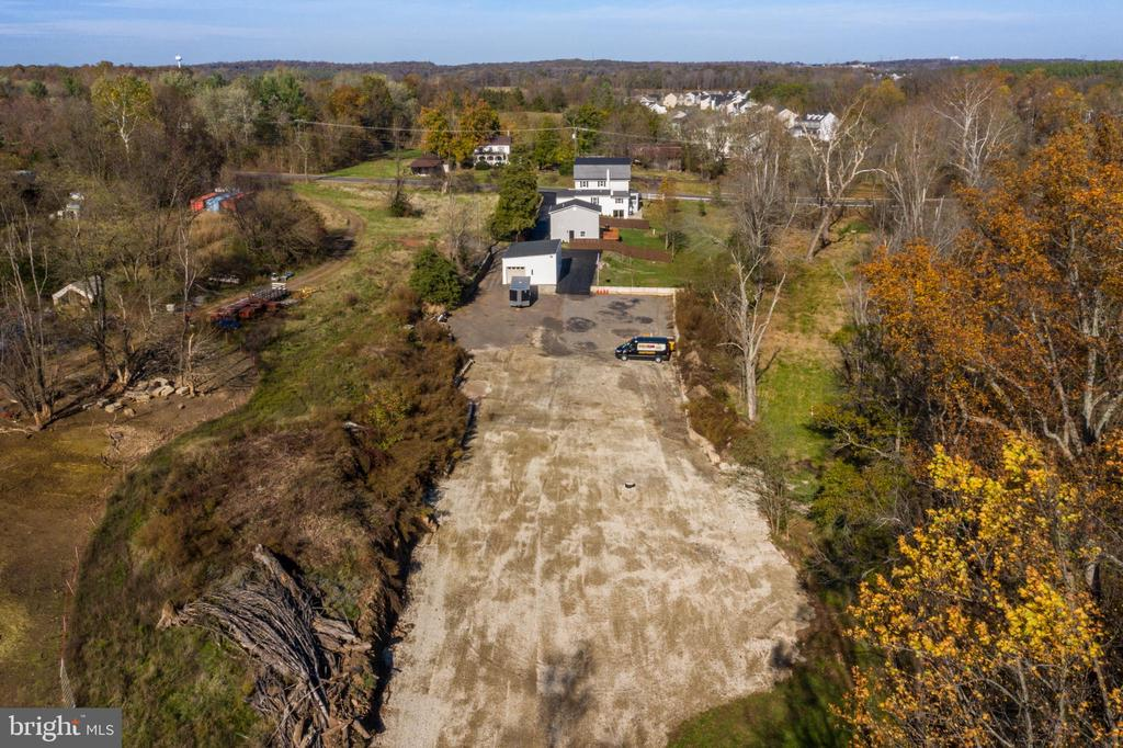 Leveled, gravel lot behind updated garage building - 41217 & 41223 JOHN MOSBY HWY, ALDIE