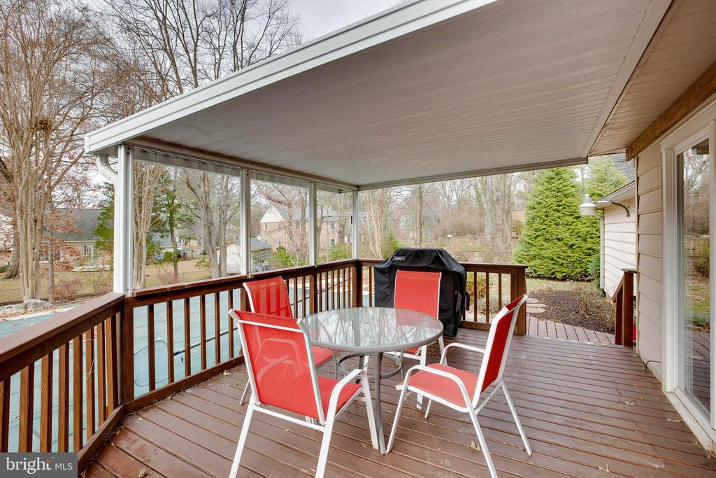 Deck overlooking pool and backyard - 4301 NORBECK RD, ROCKVILLE