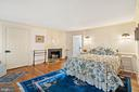 bedroom with wood burning fireplace - 20775 AIRMONT RD, BLUEMONT