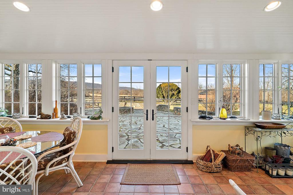 french doors lead to large stone patio - 20775 AIRMONT RD, BLUEMONT