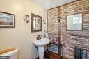 powder room with original brick wall - 20775 AIRMONT RD, BLUEMONT