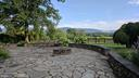 stone patio and retaining walls - 20775 AIRMONT RD, BLUEMONT