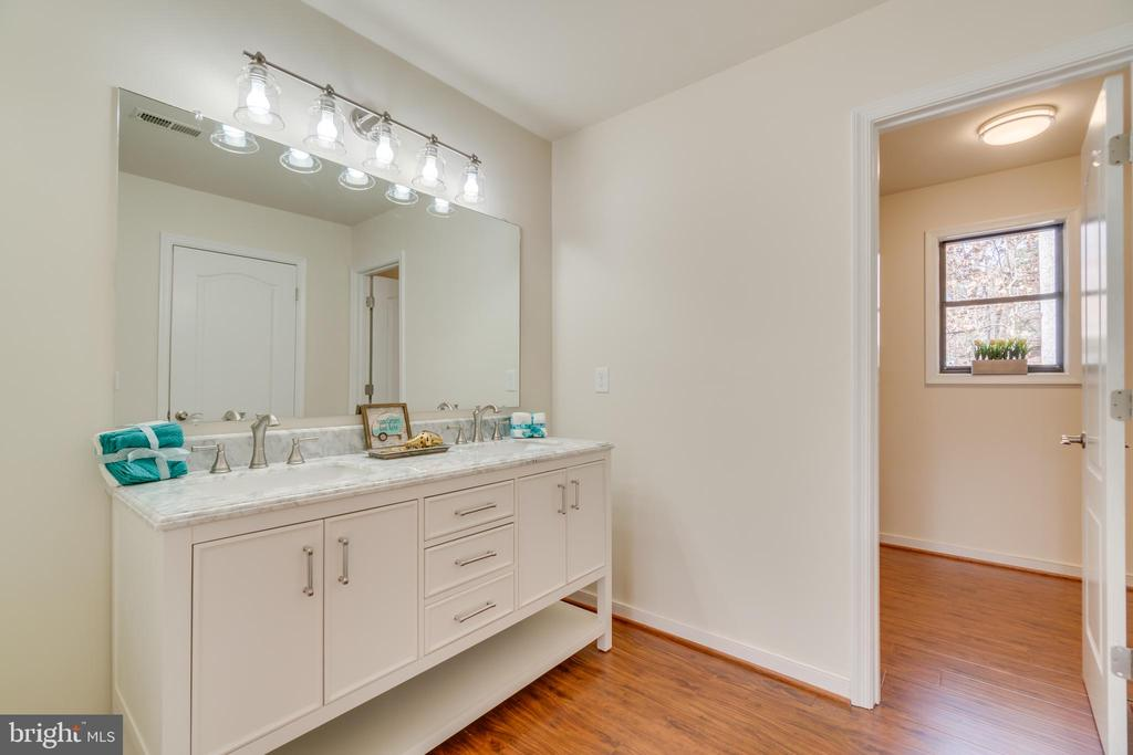 Master bath with hardwood, new vanity  & lights. - 4229 LAKEVIEW PKWY, LOCUST GROVE