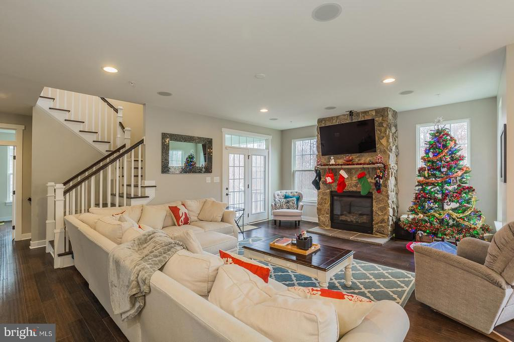Warm inviting family room with gas fireplace - 17101 GULLWING DR, DUMFRIES