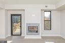Master bedroom with double sided fireplace - 8302 WOODMONT AVE #901, BETHESDA