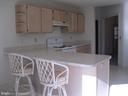 Kitchen with breakfast bar - 134 HARRISON CIR, LOCUST GROVE