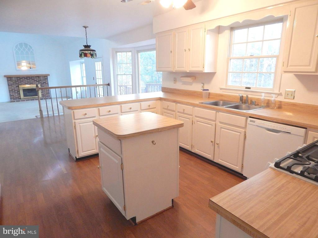 Kitchen into family room - cabinets galore! - 6205 PROSPECT ST, FREDERICKSBURG