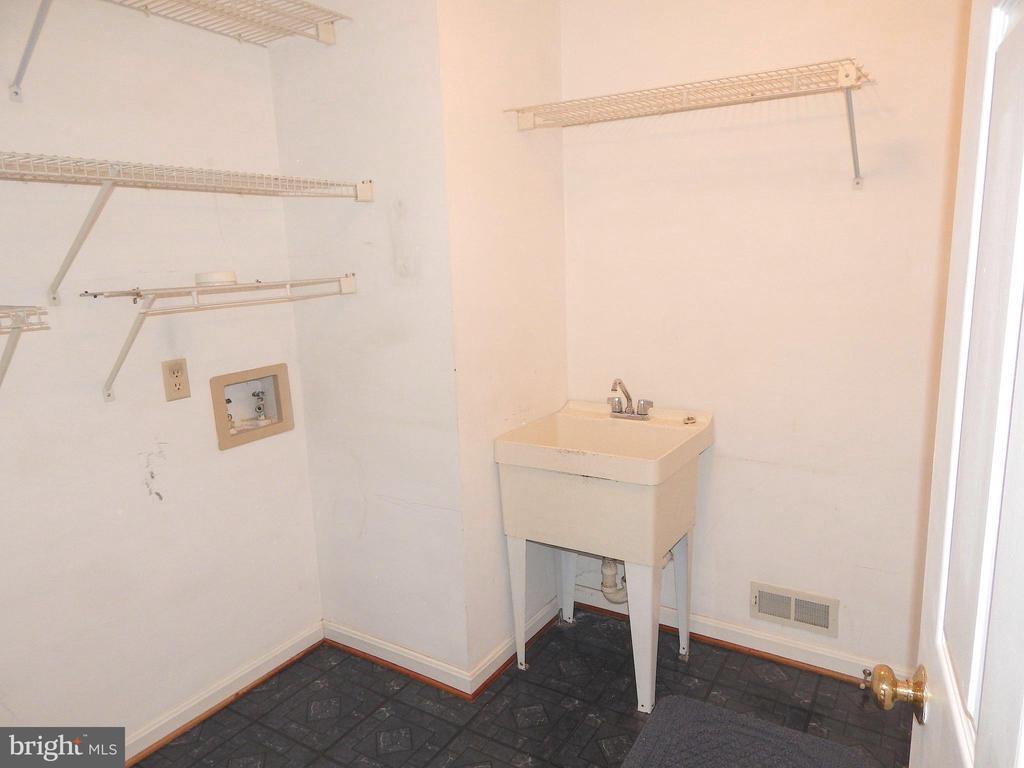 Laundry room w/utility sink and shelves - 6205 PROSPECT ST, FREDERICKSBURG