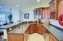Lower level wet bar - 18918 CANOE LANDING CT, LEESBURG