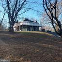 House sits overlooking lovely hillside - 39006 LIME KILN RD, LEESBURG