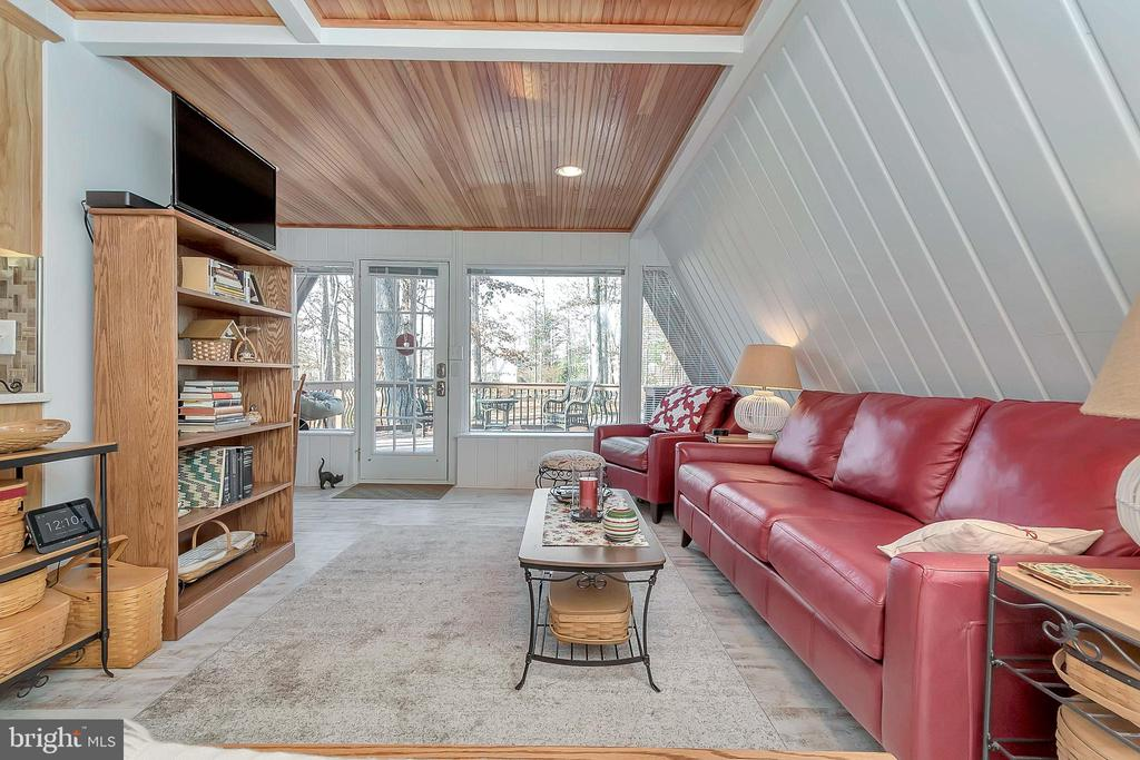 living room with wood accent ceiling - 224 CREEKSIDE DR, LOCUST GROVE