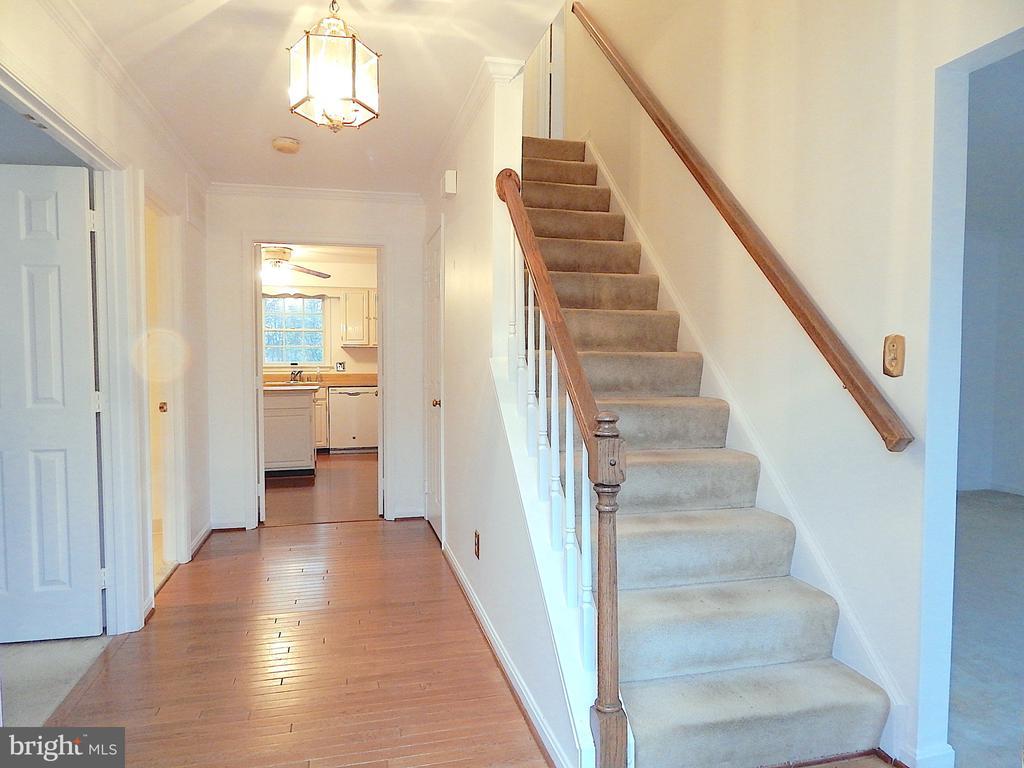Foyer with wood floor, view from front door - 6205 PROSPECT ST, FREDERICKSBURG