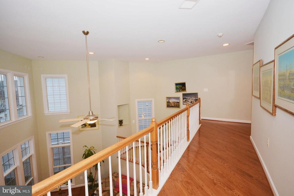 Second level overlooks spacious family room. - 702 PILOT HOUSE DR, ANNAPOLIS