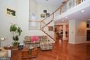 Family Room with open stairwell to second floor. - 702 PILOT HOUSE DR, ANNAPOLIS