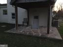 Covered stone back patio - 652 ALABAMA DR, HERNDON