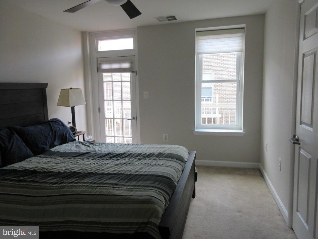 Master bedroom on 2nd level with balcony and bath - 1308 CLIFTON ST NW #401, WASHINGTON