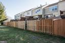 Fully fenced yard backs to common area - 512 GINGER SQ NE, LEESBURG