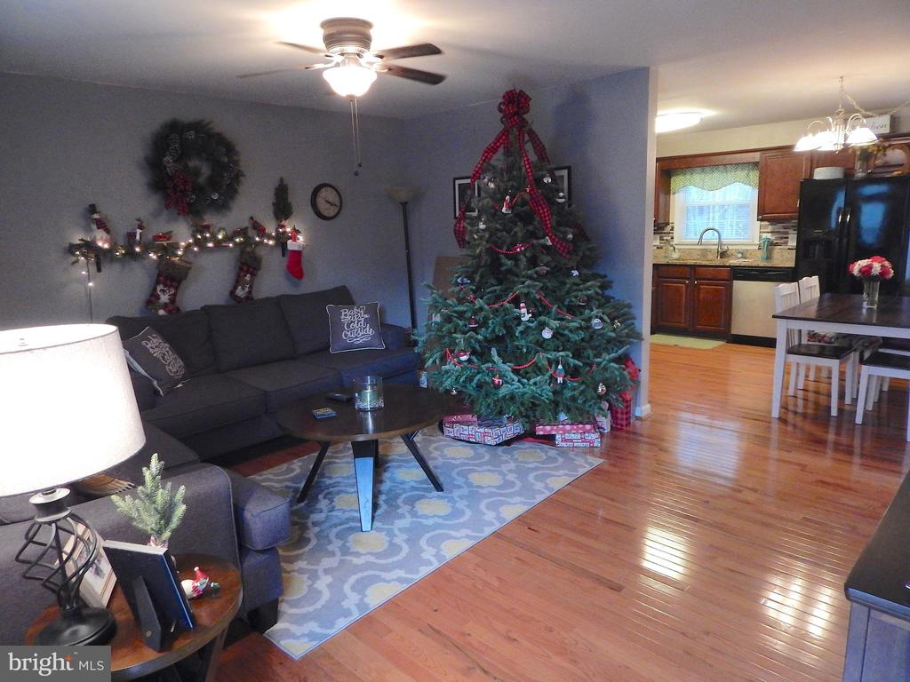 Spacious living room with wood floors, ceiling fan - 6307 TOWLES MILL RD, SPOTSYLVANIA