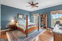 Bedroom two with ceiling fan. Mountain views - 37239 HUNT VALLEY LN, PURCELLVILLE