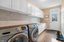 Large main level laundry with sink and cabinets. - 37239 HUNT VALLEY LN, PURCELLVILLE
