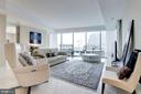 Large living spaces highlighted by walls of window - 1881 N NASH ST #1111, ARLINGTON