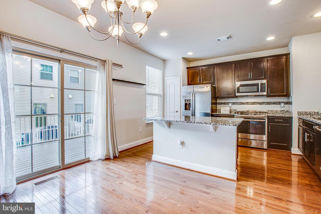 Open kitchen with separate dining area - 4515 POTOMAC HIGHLANDS CIR #133, TRIANGLE