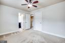 Master bedroom with private bath and ceiling fan. - 4515 POTOMAC HIGHLANDS CIR #133, TRIANGLE